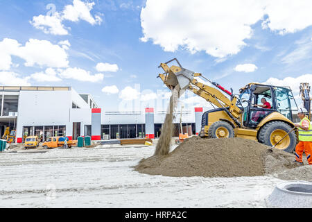 Zrenjanin, Vojvodina, Serbia - June 29, 2015: View on backhoe while he piles up ground at construction site. - Stock Photo