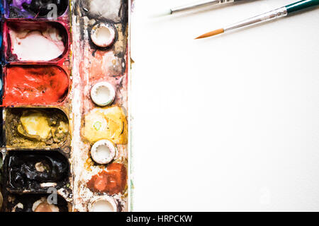 Colorful Watercolor Palette close up on blurry focus. - Stock Photo