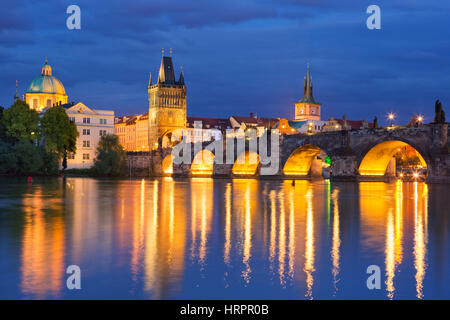 The Charles Bridge over the Vltava River in Prague, Czech Republic, photographed at night. - Stock Photo