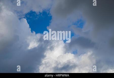 cloudscape,storm clouds against a blue sky - Stock Photo