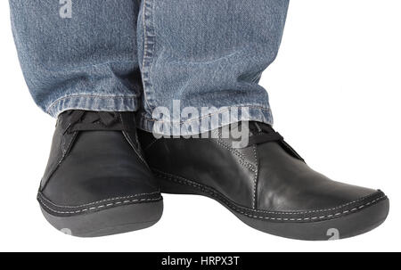 Black leather shoes, grey denim indigo jeans, casual men's sneakers closeup, man's feet foot, legs isolated - Stock Photo