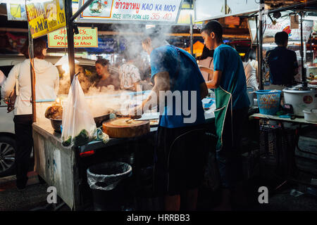 Chiang Mai, Thailand - August 27, 2016:  Father and sun cooking food at the Saturday Night Market on August 27, - Stock Photo