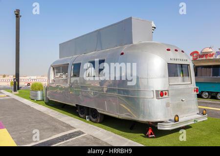 DUBAI, UAE - NOV 27, 2016: Airstream caravan food truck at the Last Exit food trucks park on the E11 highway between - Stock Photo