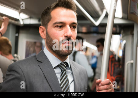 Portrait of a man traveling in a subway train - Stock Photo