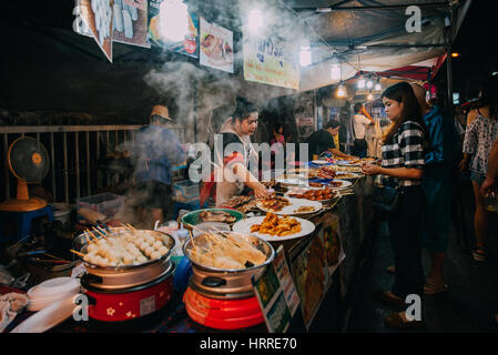 Chiang Mai, Thailand - August 27, 2016:  Thai woman sales at the Saturday Night Market on August 27, 2016 in Chiang - Stock Photo