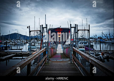Walkway down to Crescent Harbor docks in Sitka, Alaska, USA. Photography by Jeffrey Wickett, NorthLight Photography. - Stock Photo