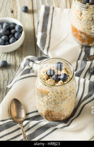 Healthy Homemade Overnight Oats Oatmeal with Chia and Peanut Butter - Stock Photo