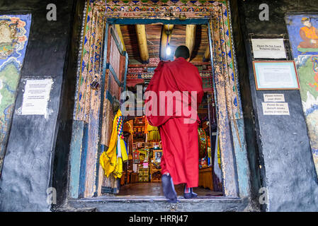 Thiksey, India - August 24, 2015: A buddhist monk entering in the prayer hall of Thiksey monastery for the Puja, - Stock Photo