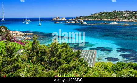 Bay with house rooftop, Cavallo Island, Corsica, France - Stock Photo