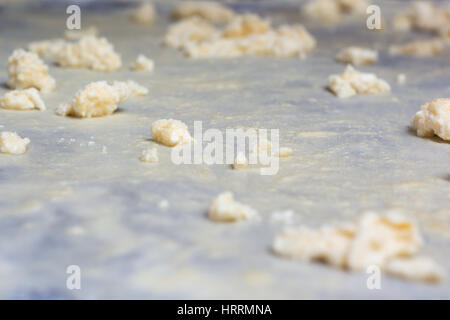 Homemade Phyllo or strudel dough with cheese on a home table cloth ready for cheese burek pie or other kind of traditional - Stock Photo