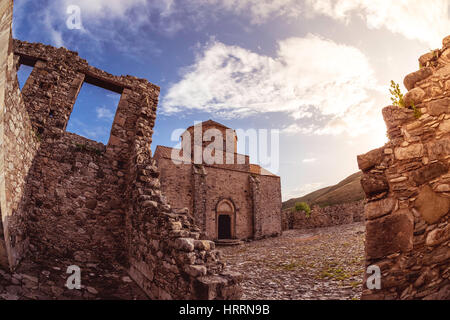 Sunset over Panagia tou Sinti Monastery. Paphos district. Cyprus - Stock Photo