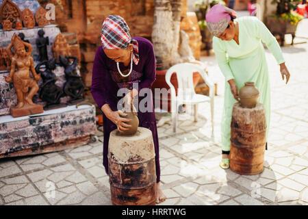 Nha Trang, VIETNAM - February 2016 - unidentified women create clay pot  traditional handicraft in Vietnam - Stock Photo