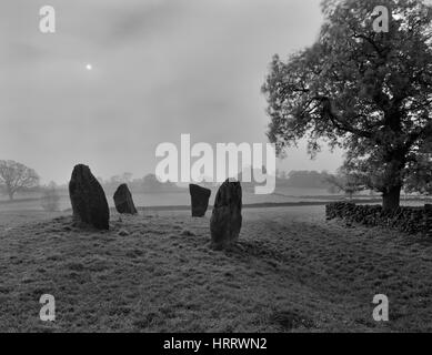 The 4 remaining stones of Nine Stone Close stone circle, Derbyshire, looking S to Robin Hood's Stride where the - Stock Photo