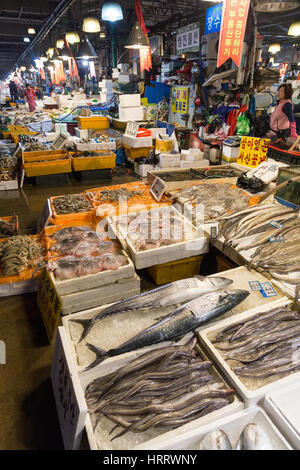 Fish and other seafood and people at the Noryangjin Fisheries Wholesale Market (or Noryangjin Fish Market) in Seoul, - Stock Photo
