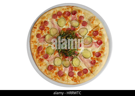 Top view of pizza with sausage, ham and bacon decorated with fried green onion - Stock Photo