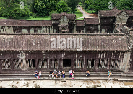 Siem Reap, Cambodia - 25 June, 2014: The group of tourists resting in Angkor Wat Temple  on June 25, 2014, Siem - Stock Photo
