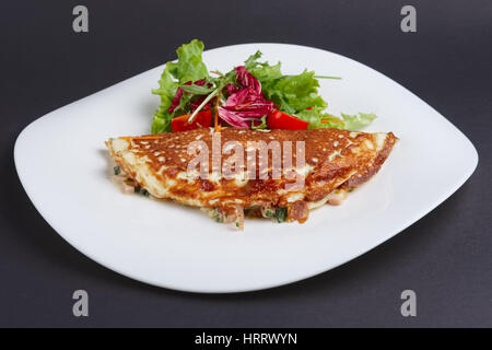 omelet with ham and vegetables - Stock Photo