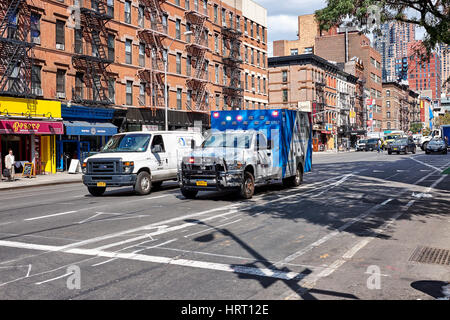 NEW YORK CITY - SEPTEMBER 26, 2016: Ambulance with emergency light and a small truck on 9th Avenue and 51st W Street - Stock Photo
