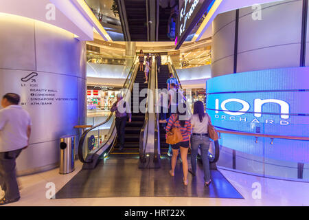 Tourists and locals shopping in a shopping center, escalators, Ion Orchard Mall, Orchard Road, Singapore, Asia, - Stock Photo