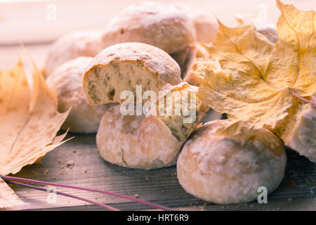 little cakes with icing on wooden background - Stock Photo