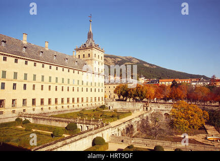 Royal Monastery and view of the village. San Lorenzo del Escorial, Madrid province, Spain. - Stock Photo