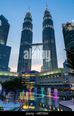 Kuala Lumpur, Malaysia -  24 July 2014: Fountain show at night in front of Petronas Twin Towers and Suria KLCC mall - Stock Photo