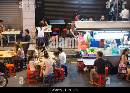 Georgetown, Malaysia - 03 August, 2014: The crowd of people dining at the street food stalls on Lebuh Chulia in - Stock Photo