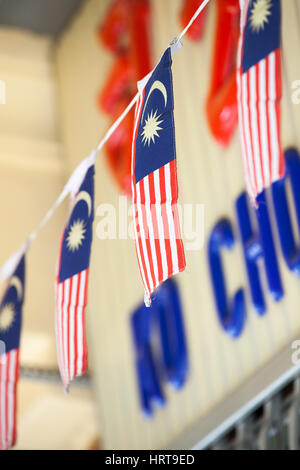 Penang, Malaysia - 03 August 2014: The Garland of Malaysian flags on the street, Penang, Malaysia on 03 August 2014. - Stock Photo