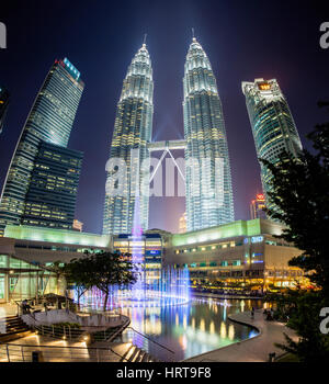 Kuala Lumpur, Malaysia -  24 July 2014: Fountain show at night in front of Petronas Twin Towers and Suria KLCC mall. - Stock Photo