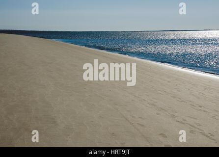 Sun reflects off of Atlantic Ocean along South Beach on Hilton Head Island, South Carolina in the United States. - Stock Photo