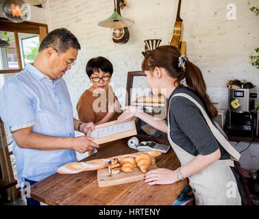 Small bakery business buying customer - Stock Photo
