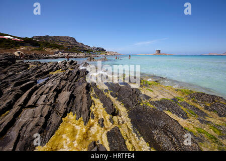 The sea in Stintino with La Pelosa tower, Sardinia, Italy - Stock Photo