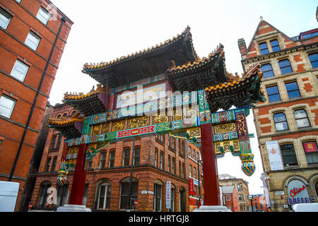 The ornate entrance arch to China Town Faulkner Street Manchester city centre Manchester England UK - Stock Photo