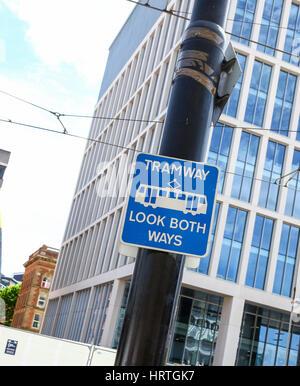 A warning sign saying tramway, look both ways - Stock Photo