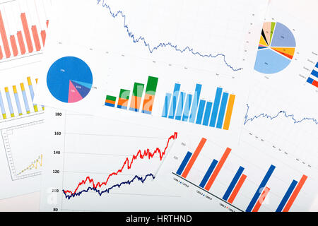 business finance analytics - papers with graphs and charts - Stock Photo