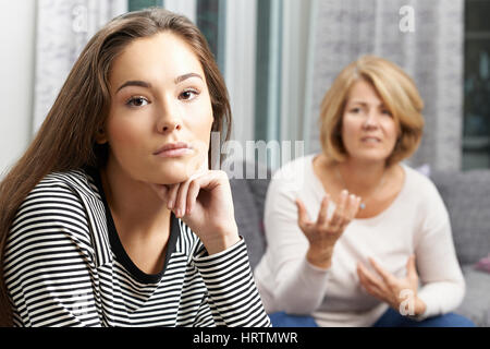 Bored Teenage Girl Being Told Off By Mother - Stock Photo