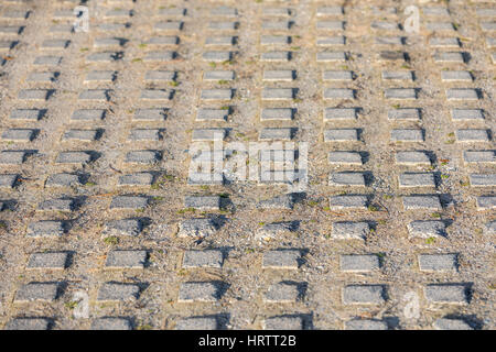 concrete grid that is part of a driveway - Stock Photo