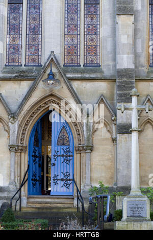 Wooden church door decorated in Cast iron shapes - Stock Photo