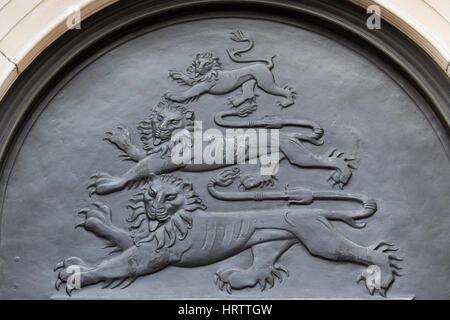 Tree Lions on brass security doors London - Stock Photo