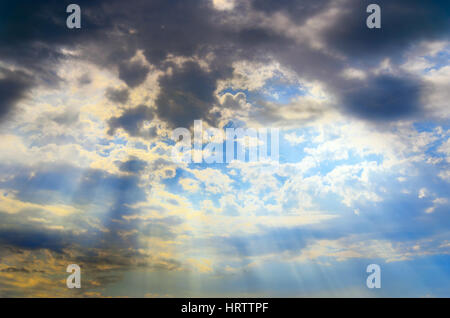 Blu sky with clouds and sun rays - Stock Photo