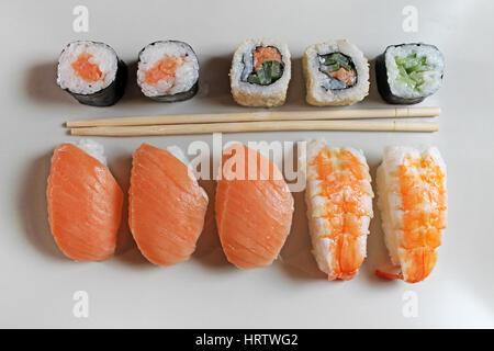 Preparation sushi roll on restaurant - Stock Photo