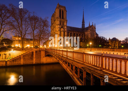 Notre Dame de Paris cathedral at dawn with  the Pont au Double and the Seine River. Ile de La Cite. 4th Arrondissement, - Stock Photo