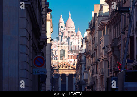 Sacre-Coeur Basilica or Basilica of the Sacred Heart of Jesus and Notre-Dame de Lorette church, seen from Rue Laffitte - Stock Photo