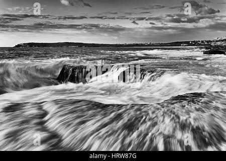 Strong surf splash and broken wave on shore near Maroubra beach in Sydney, Australian pacific coast. Warm morning - Stock Photo