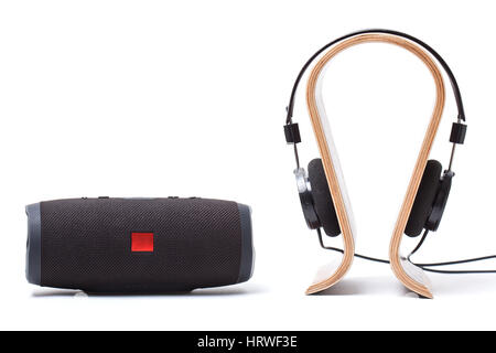 headphones in black and wireless portable speaker system on a white background. isolated - Stock Photo