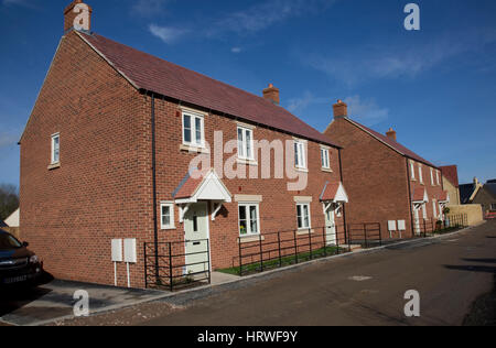 New semi-detached red brick starter homes in Mickleton; current new building in several sites in the village will - Stock Photo