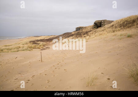 World War II concrete gun emplacements above sand dunes on North Sea coast, Scheveningen, The Netherlands - Stock Photo
