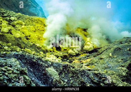 Steams rising from the fumaroles of Mount Ijen volcano in East Java, Indonesia. - Stock Photo