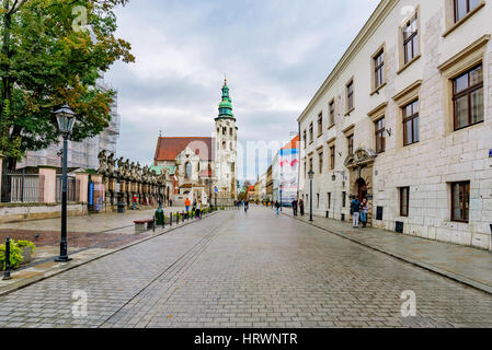 KRAKOW, POLAND - OCTOBER 04: View of a street in old town Krakow near the main square with old traditional Polish - Stock Photo