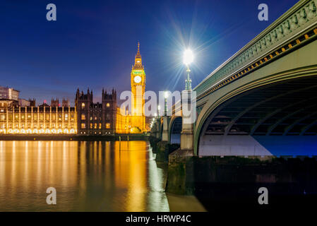 View of Houses of Parliament and River Thames at night - Stock Photo